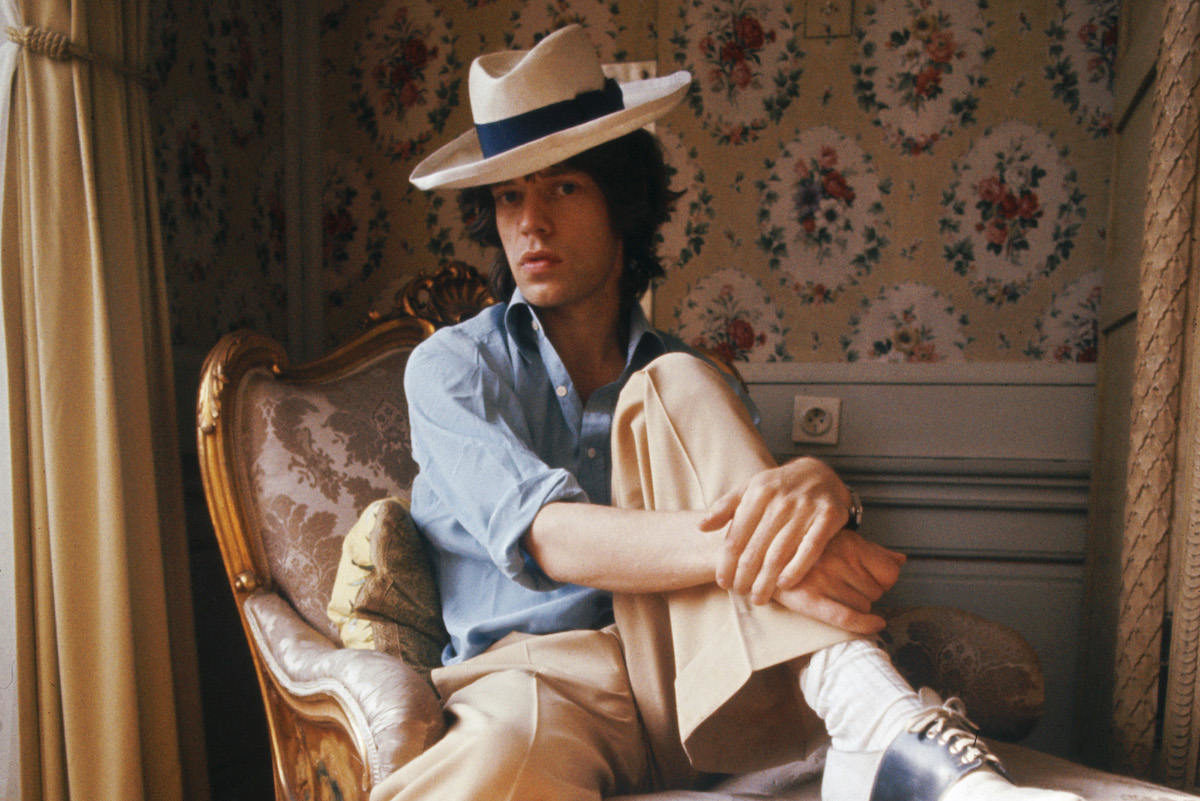c2eb7552 Mick Jagger of the Rolling Stones sitting on a chaise longue in a panama hat  and two-tone shoes, October 1973. Photo by Anwar Hussein/Hulton  Archive/Getty ...