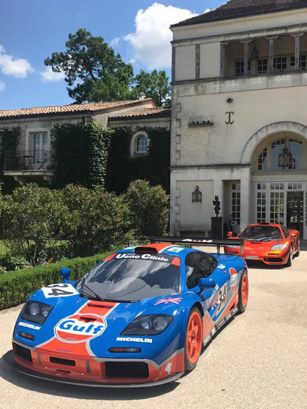 A McLaren F1 GTR In Front Of A McLaren F1 Road Car In Bordeaux.