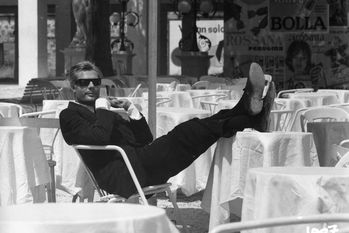 7f74290951 Marcello Mastroianni wears a classic black single-breasted suit