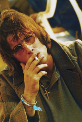 0fc13e0792b90 Gallagher channels John Lennon with round glasses and a cigarette in  Finsbury Park