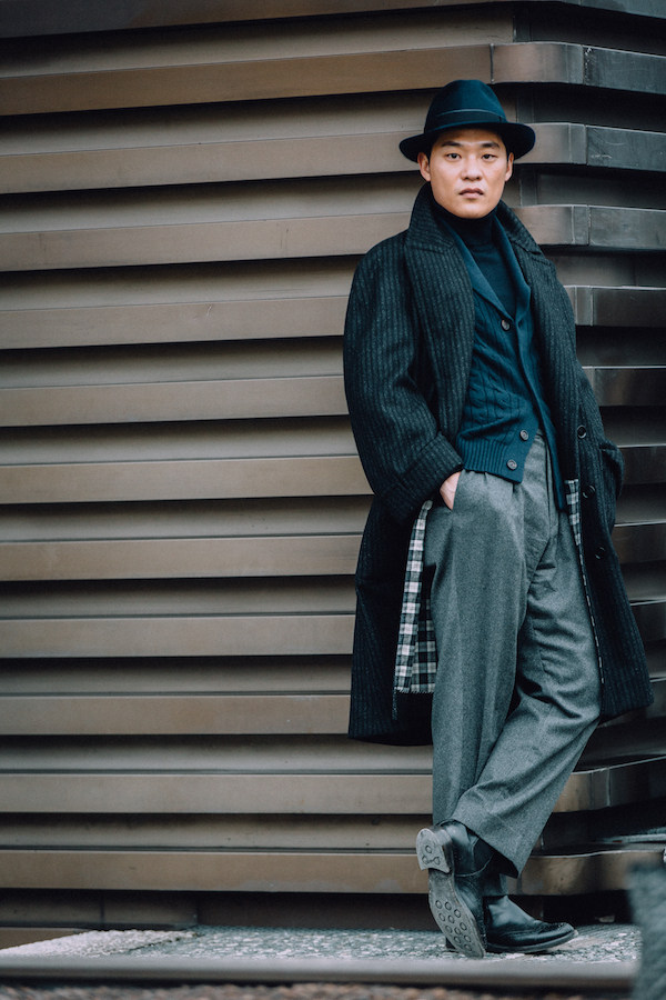 A relaxed, tonal look comprising of grey flannel trousers, a cable knitted  cardigan, rollneck and a slouchy overcoat by Seongsu Kim.