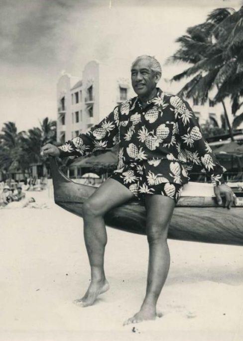 cd82aa3a Surfing legend Duke Kahanamoku wears a long sleeve pineapple motif Hawaiian  shirt with matching shorts on