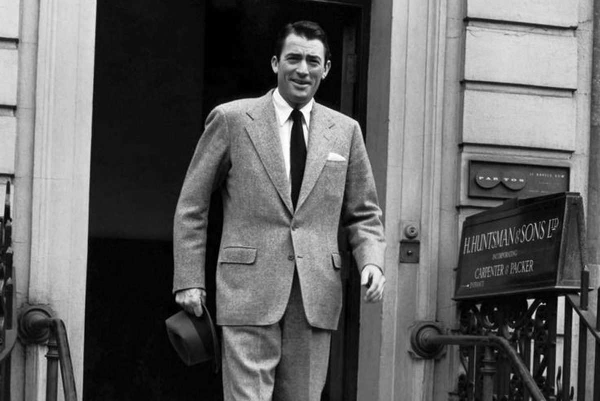 Gregory Peck leaves H. Huntsman   Sons at No. 11 Savile Row. 08ec1172d